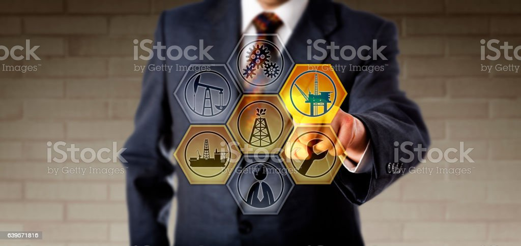 Service Manager Touching A Virtual Oil Rig Icon stock photo