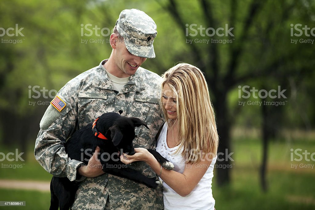 US Service Member With Young Wife and Dog royalty-free stock photo
