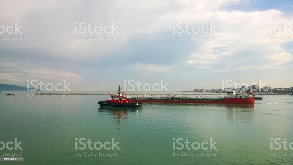 A service small boat in the harbor harbor. Tsemesskaya bay. Industrial port stock photo