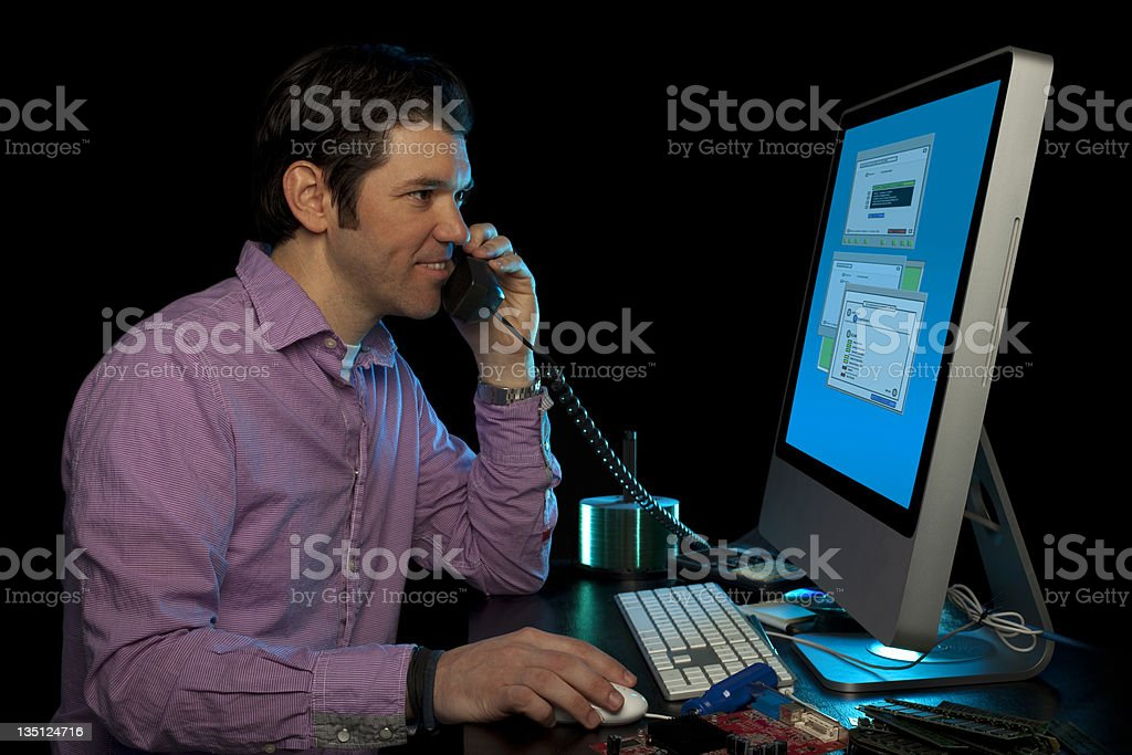 IT Service Technician Helping Customers Over The Phone royalty-free stock photo