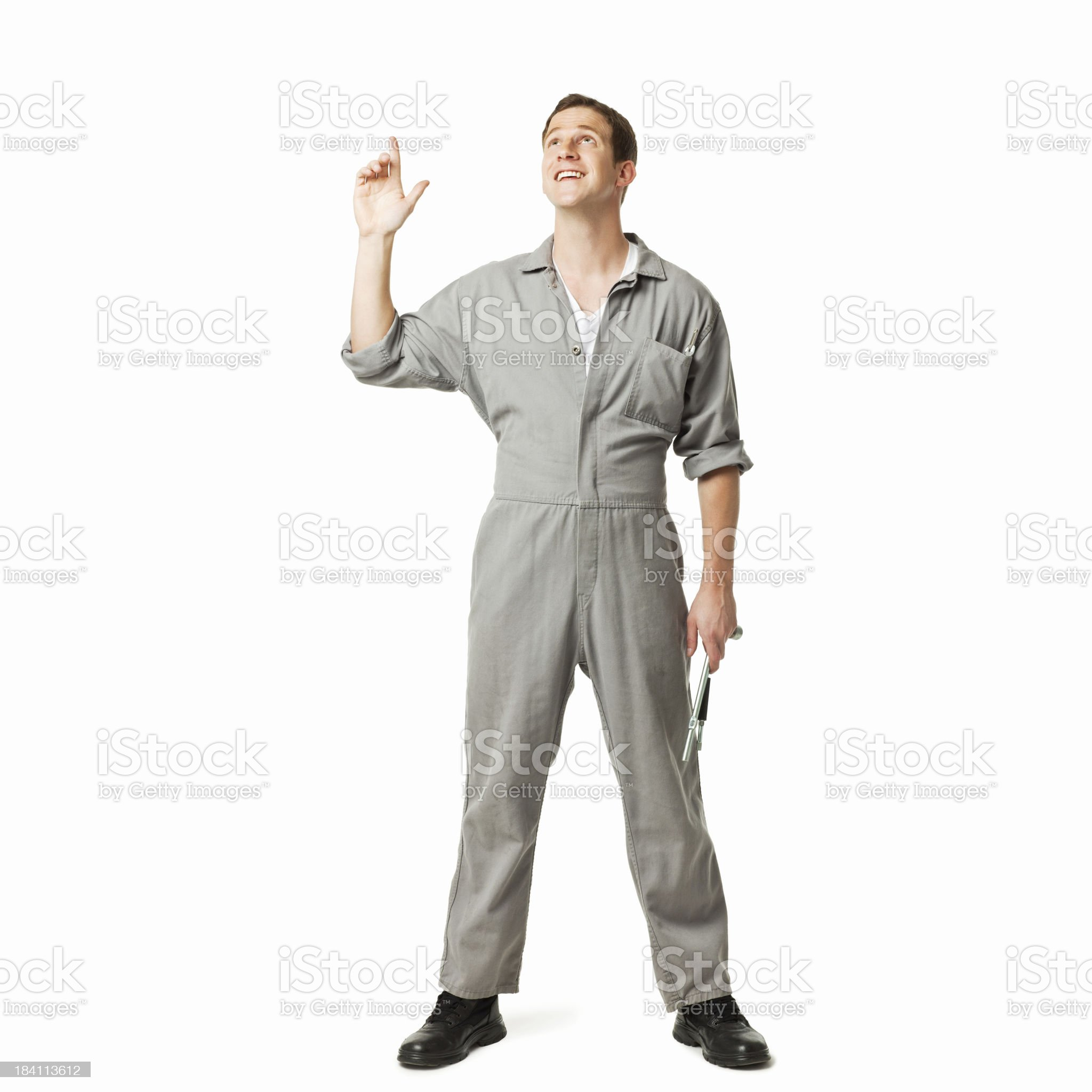 Service Technician Pointing Up - Isolated royalty-free stock photo