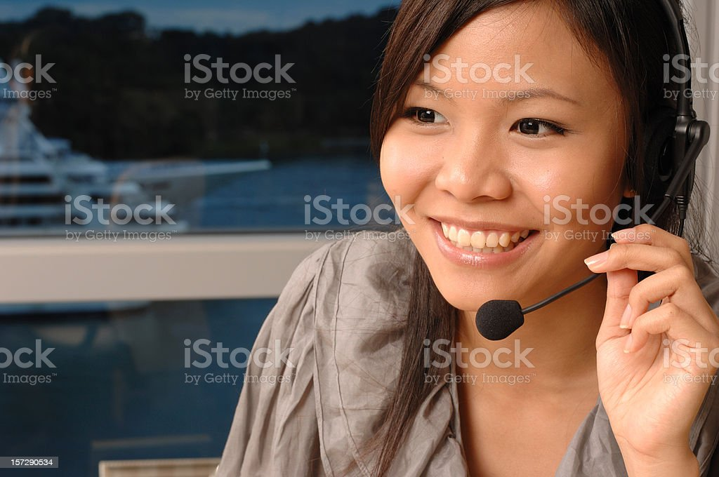 Service with a smile - Asian model royalty-free stock photo