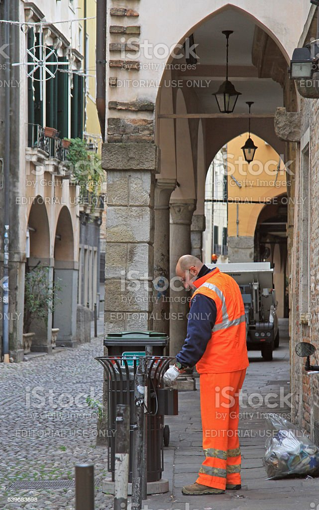 service worker is collecting trash stock photo