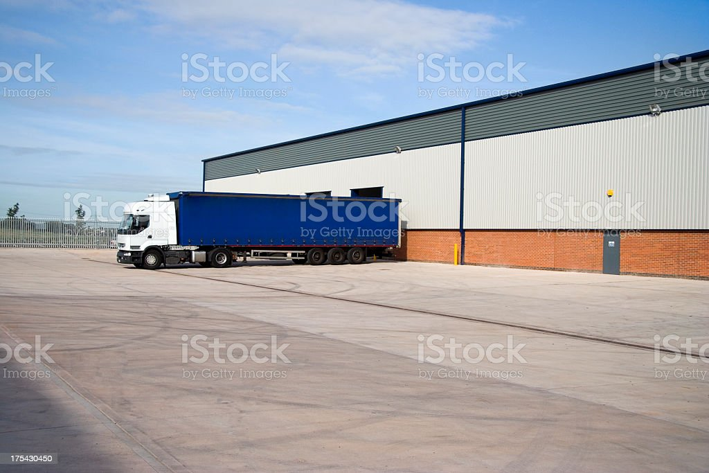 Service yard with a lone trailer royalty-free stock photo