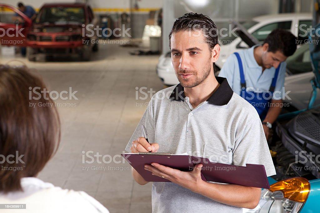 Serviceman and Customer royalty-free stock photo