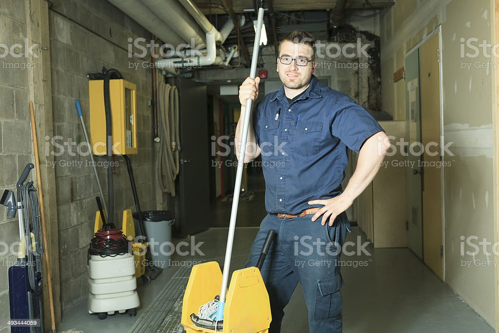 Serviceman Cleaning Floor SMile stock photo