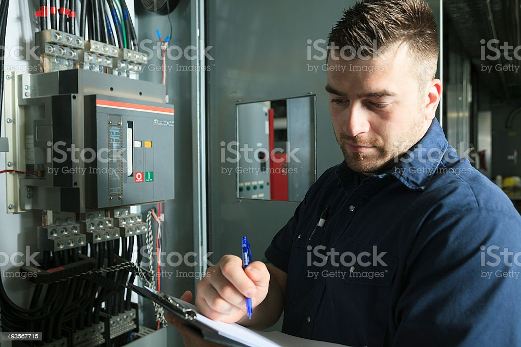Serviceman Electricity Serious Note stock photo