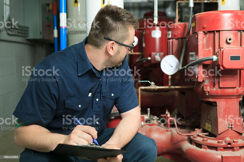 Serviceman Look Presure stock photo