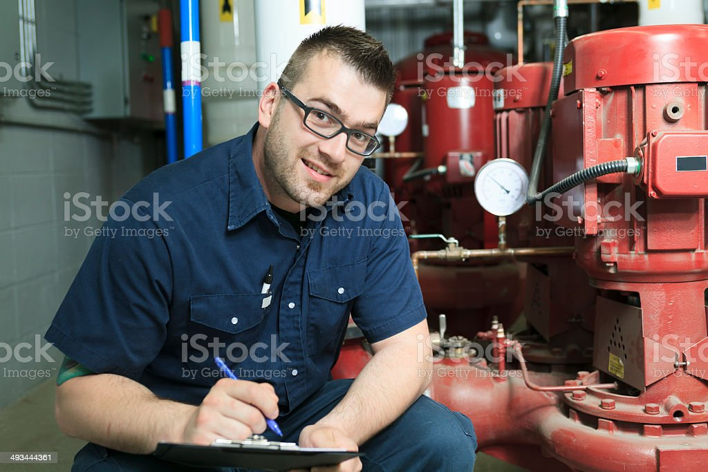 Serviceman - Note Taking stock photo