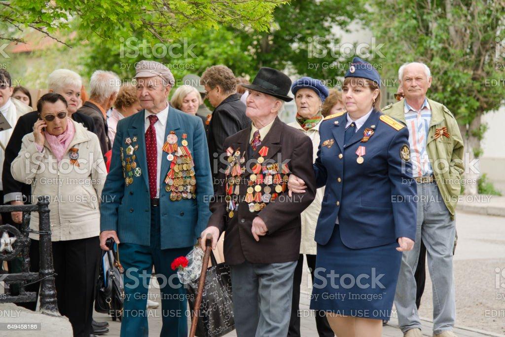 Servicemen conducting veterans at a gala event stock photo