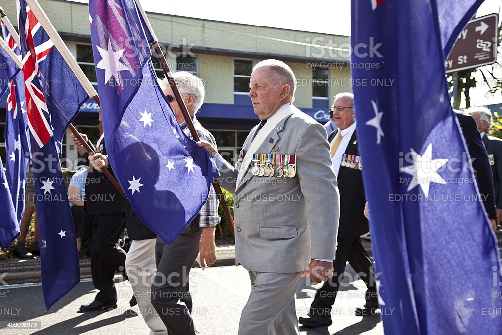 Servicemen marching on Anzac Day with Australian Flags stock photo