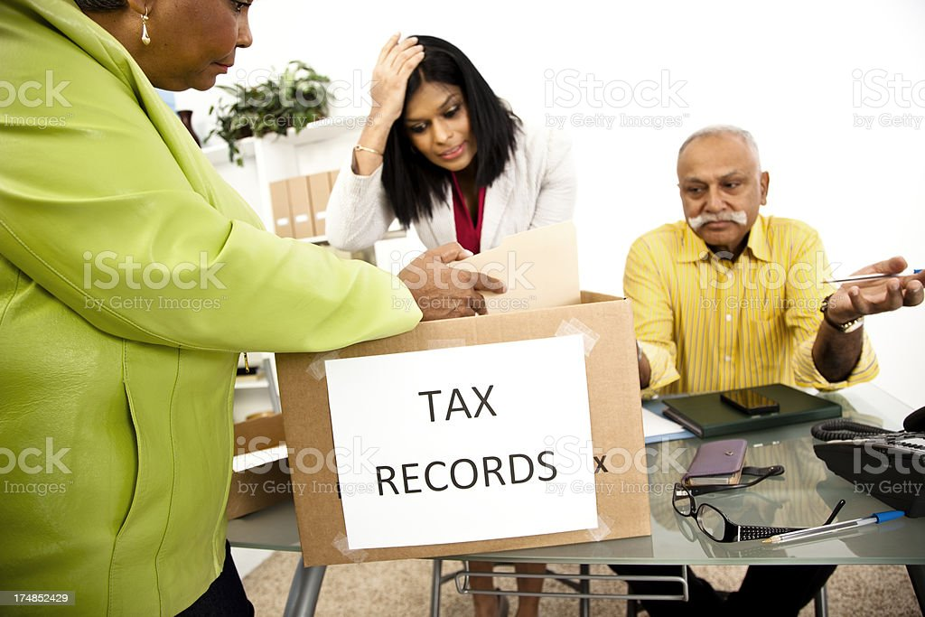 Services: Office accountants help frustrated customer with taxes for deadline royalty-free stock photo