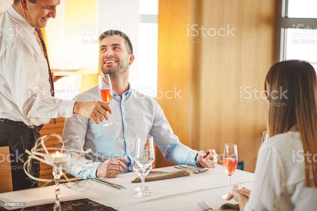 Serving a Glass of Red Sparkling Wine in a Restaurant stock photo