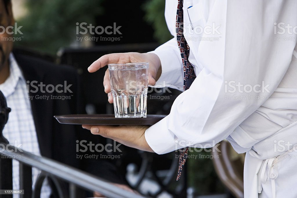 Serving a glass of water royalty-free stock photo