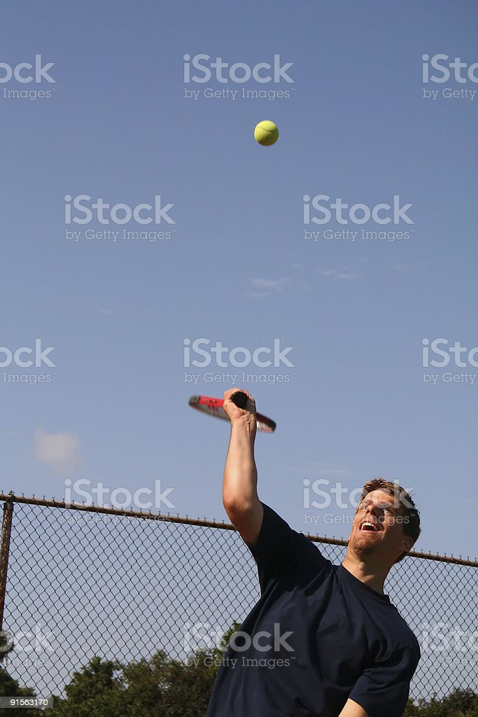 Serving a tennis ball royalty-free stock photo