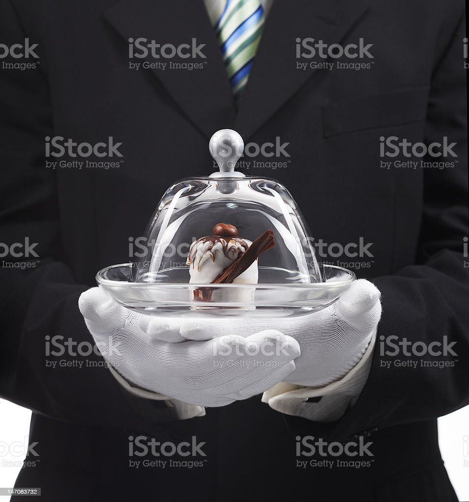 Serving a White chocolate cake royalty-free stock photo