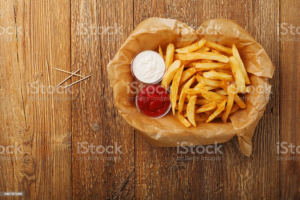 Serving Belgian fries served on paper in the basket. stock photo