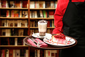 serving cheesecake in bookstore cafe