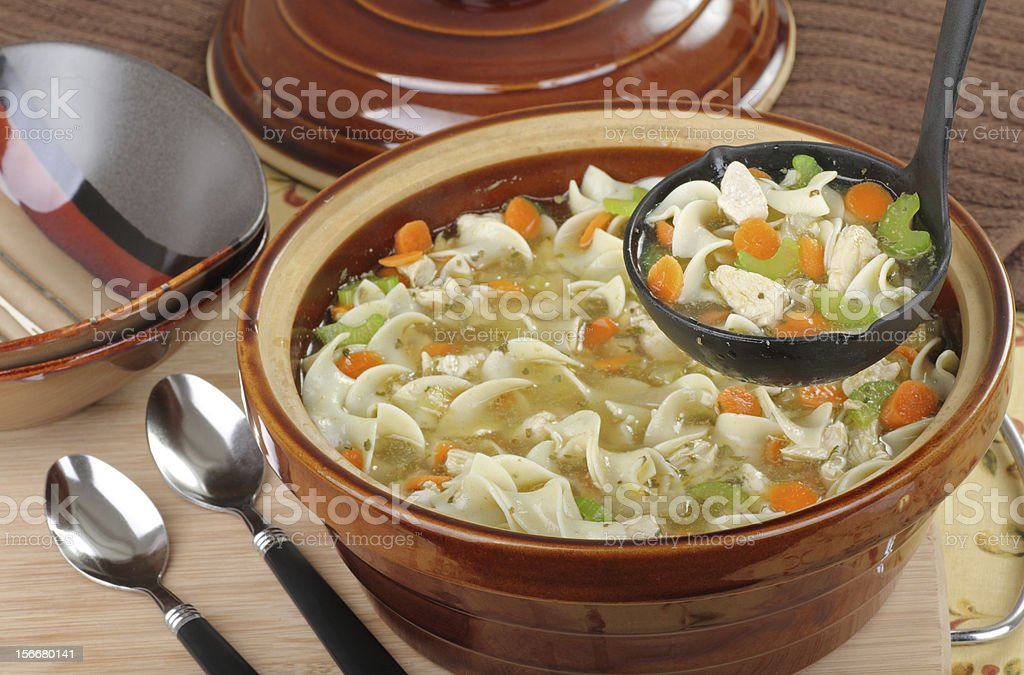 Serving Chicken Noodle Soup stock photo