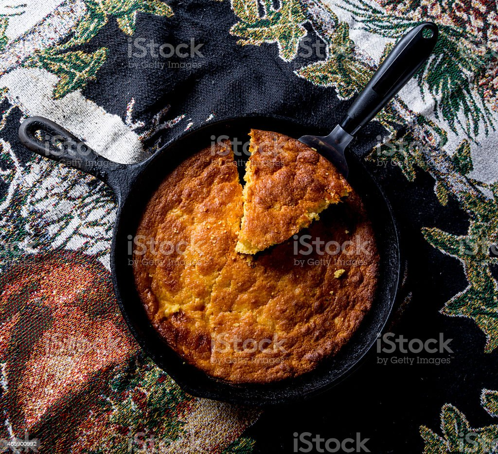 Serving Corn Bread in Cast-Iron Pan stock photo