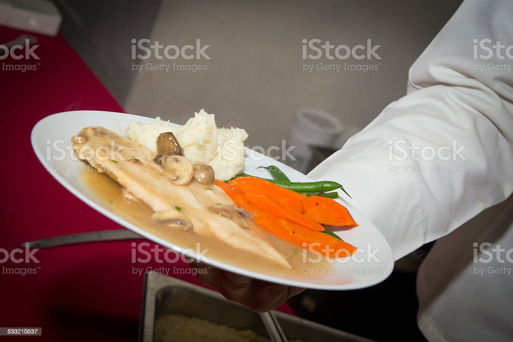 Serving food at a buffet stock photo