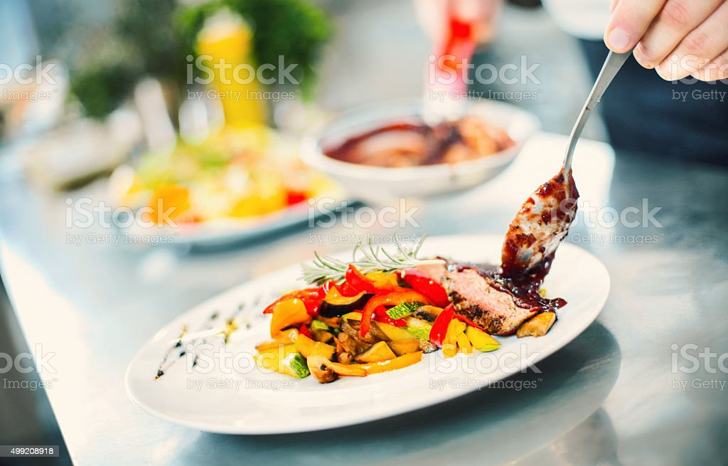 Serving food in a restaurant. stock photo