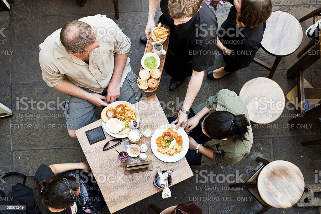 Serving Food in Restaurant stock photo