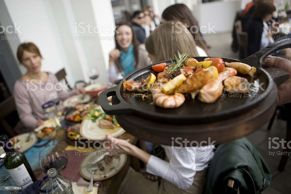 Serving food on hot pan royalty-free stock photo