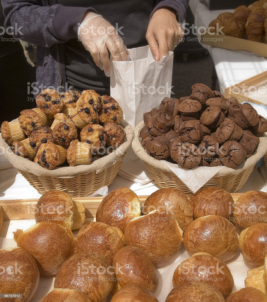Serving fresh baked pastries royalty-free stock photo
