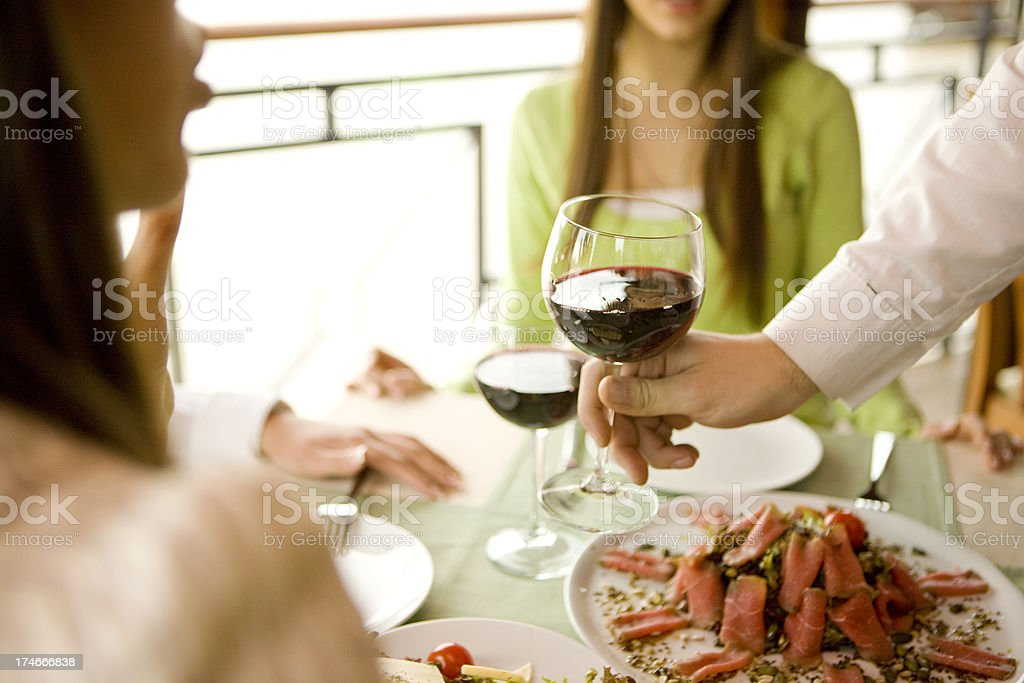 Serving glass of wine royalty-free stock photo