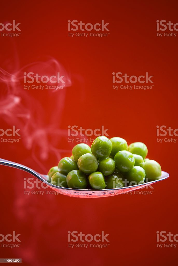 Serving green pea on spoon royalty-free stock photo
