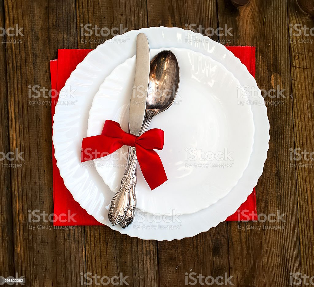 Serving holiday table, spoon, fork, knife, white plates stock photo