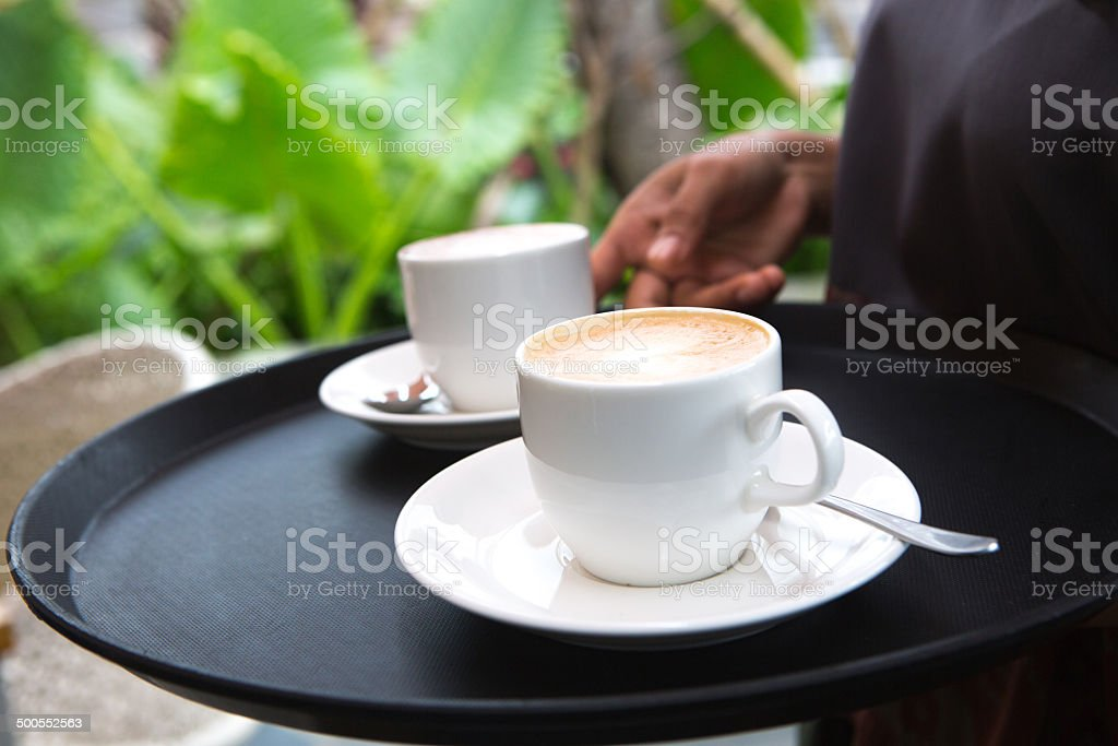 Serving hot coffee royalty-free stock photo