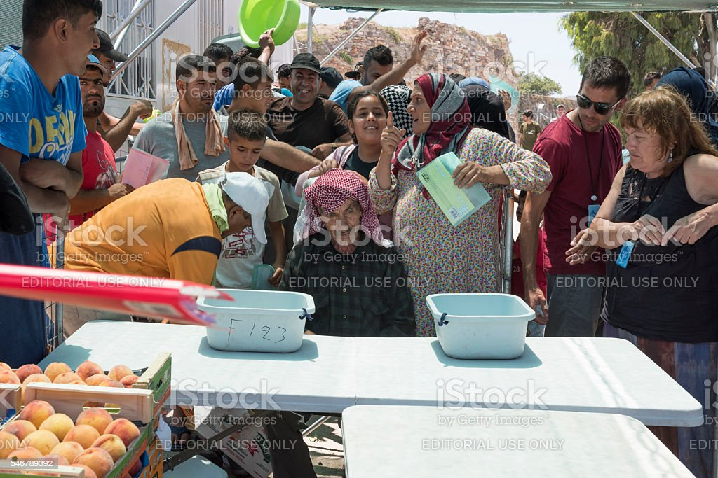 Serving lunch in Greek refugee camp stock photo
