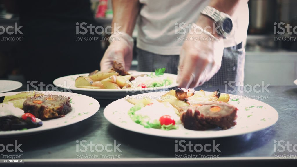 Serving lunch on plates stock photo