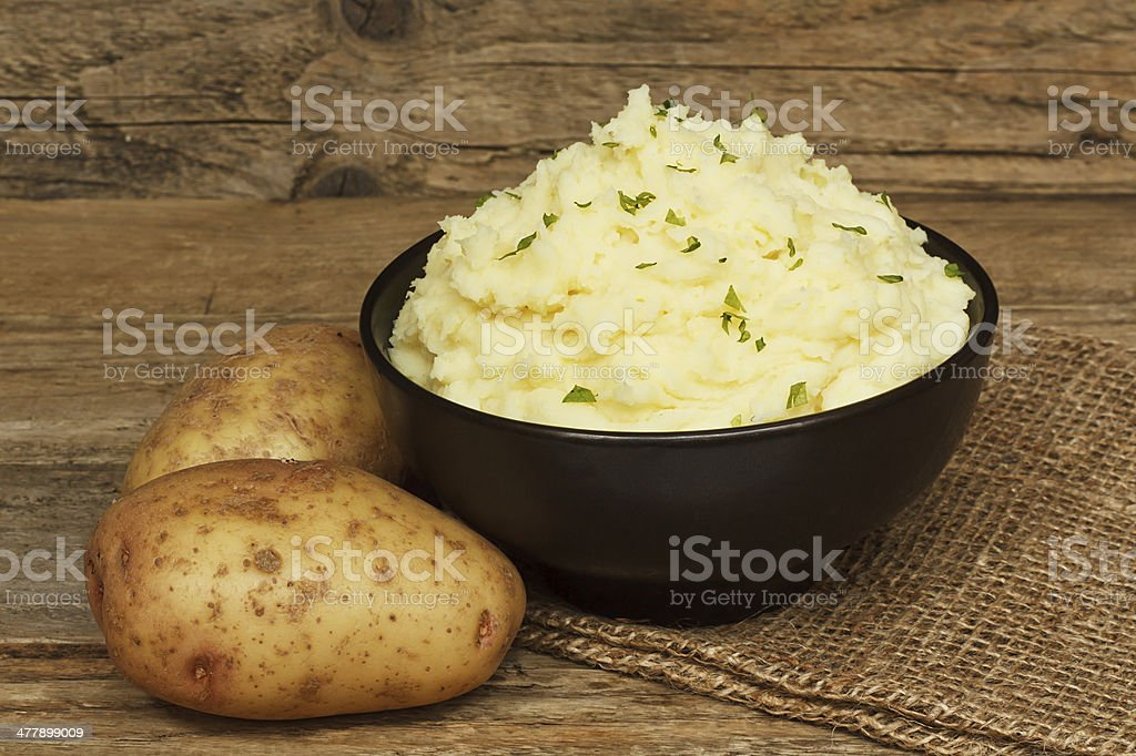 serving mashed potato stock photo