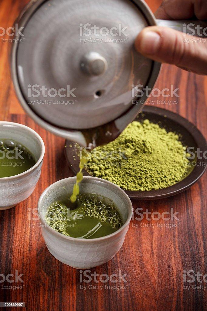 Serving matcha tea stock photo
