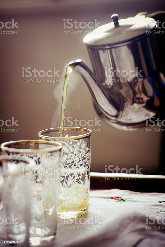 Serving moroccan green tea with mint stock photo