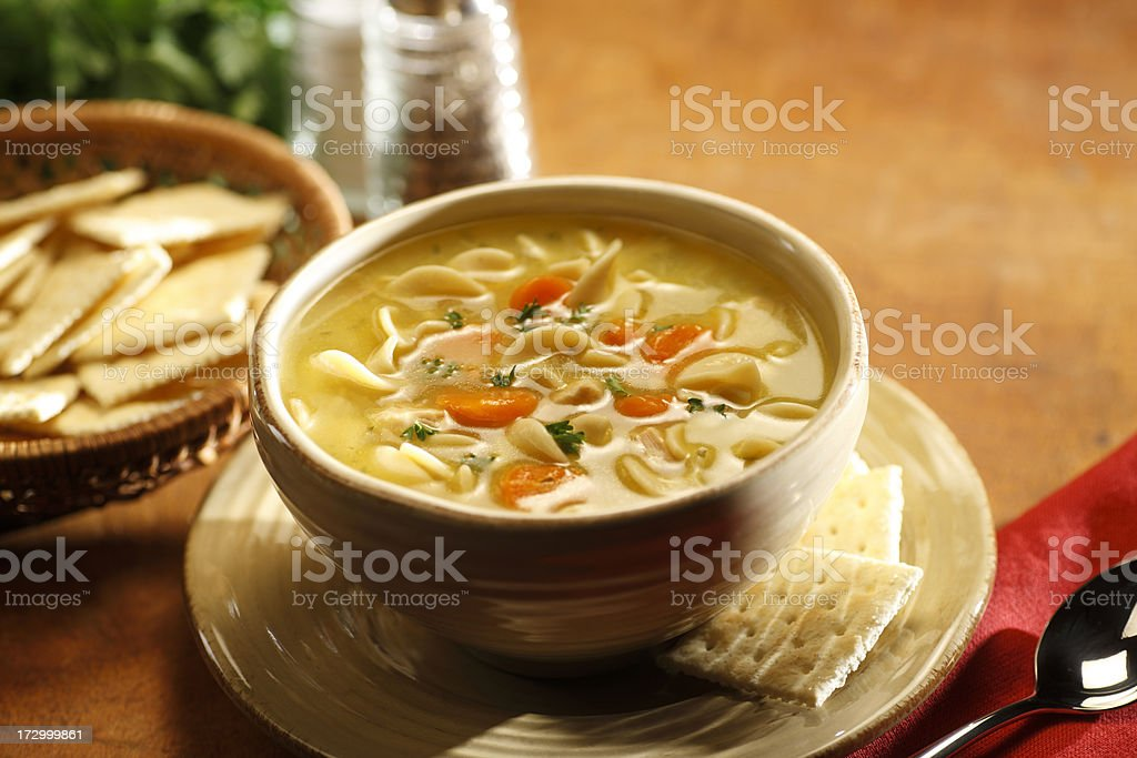Serving of chicken noodle soup in a bowl stock photo