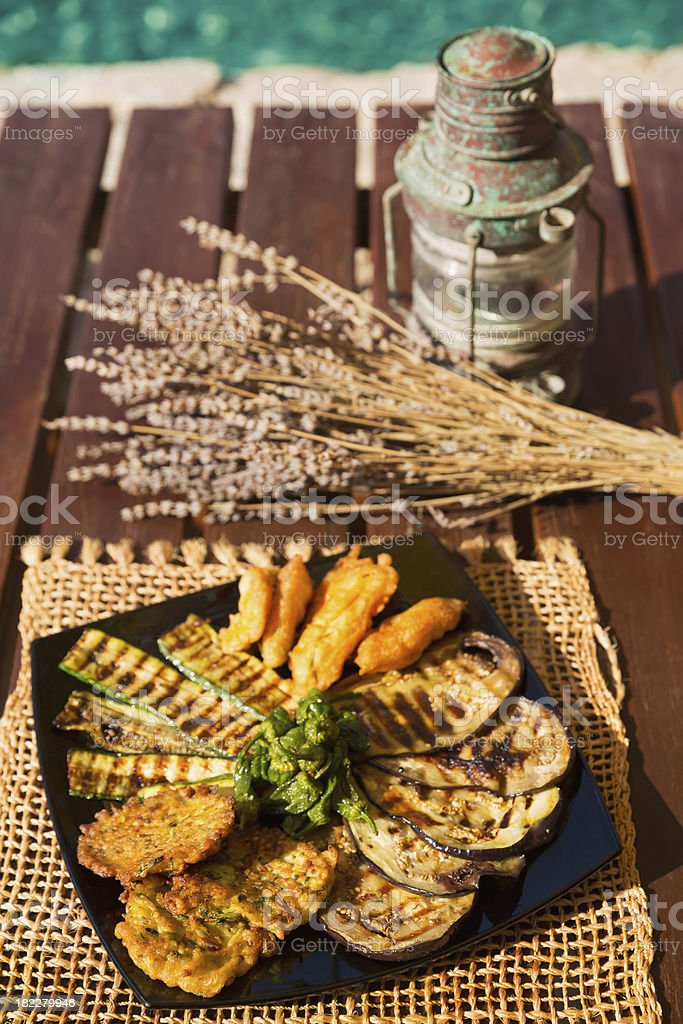 Serving of grilled zucchini, chicken and eggplant blue royalty-free stock photo