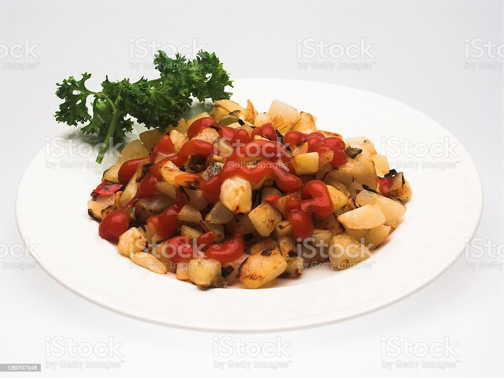 Serving of Hash Brown Potatoes with Ketchup stock photo