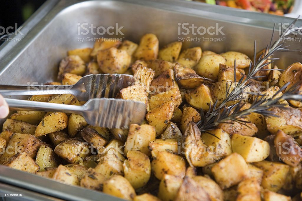Serving Roasted Potatoes royalty-free stock photo