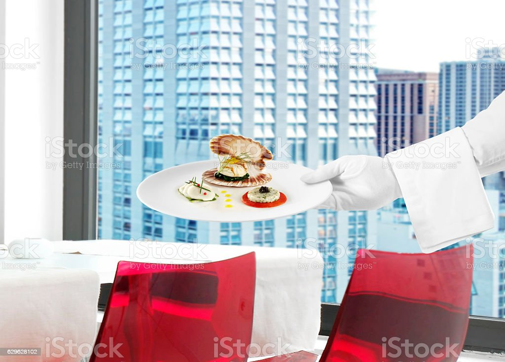 Serving seafood in a chic restaurant stock photo