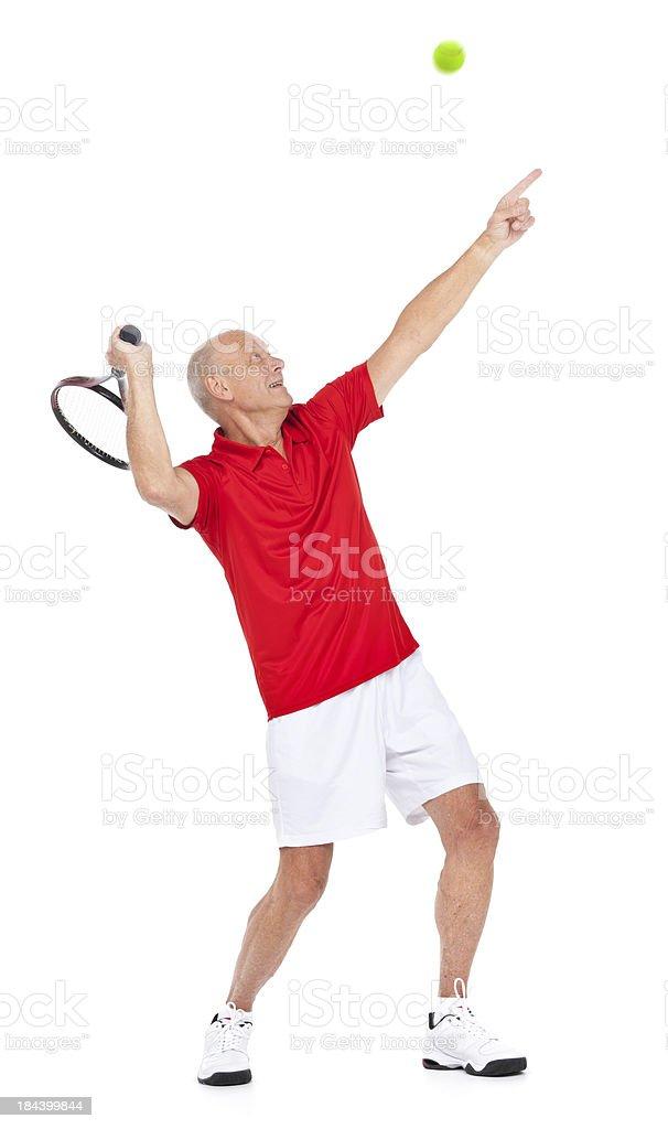 serving senior tennis player royalty-free stock photo