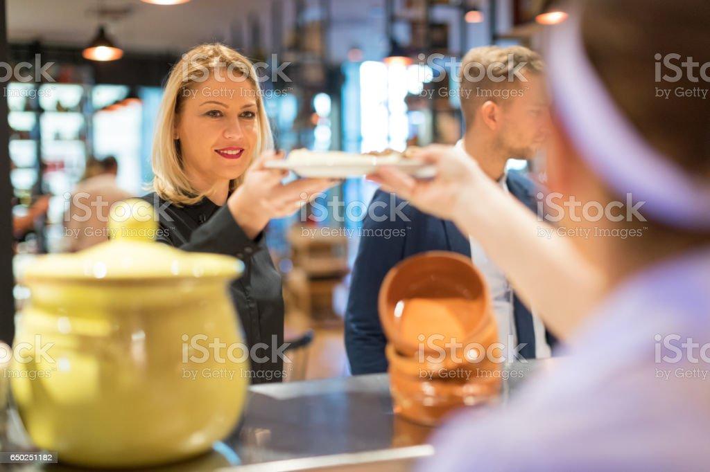 Serving soup stock photo