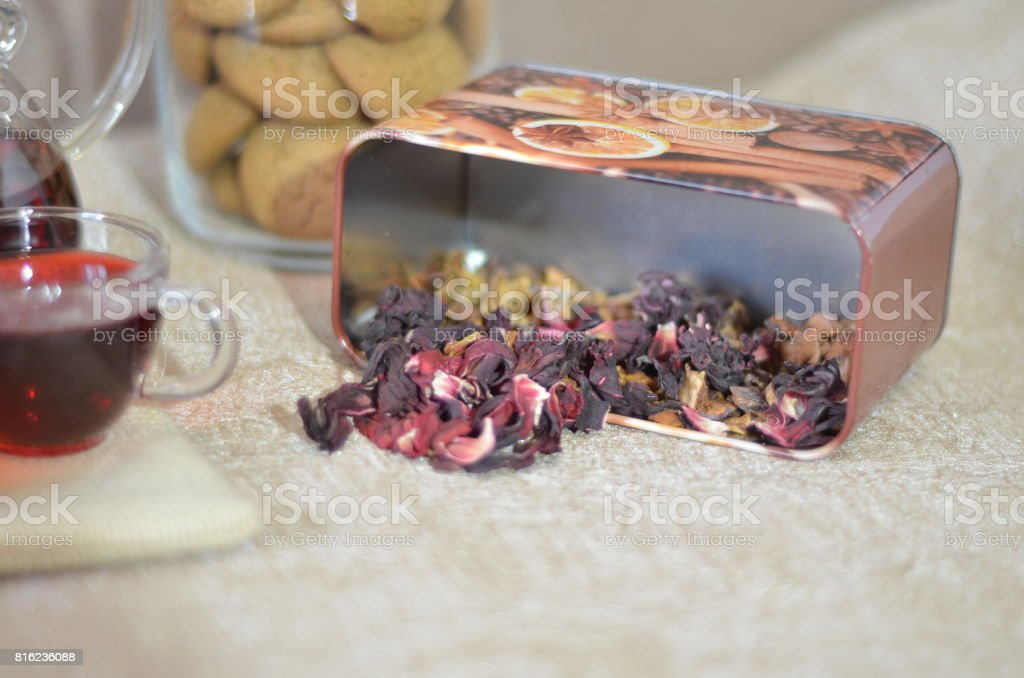 Serving table for breakfast, red tea leaves, hibiscus on the table and glass cups with red tea stock photo