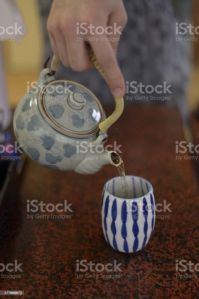 Serving tea stock photo