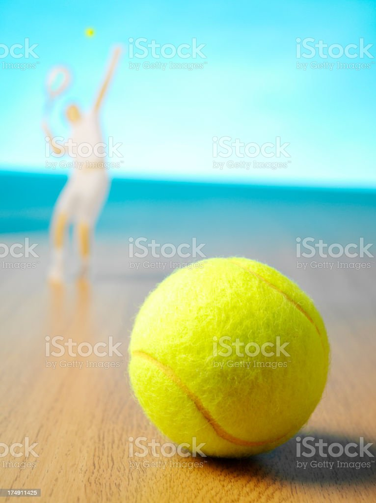 Serving the Ball in a Game of Tennis royalty-free stock photo