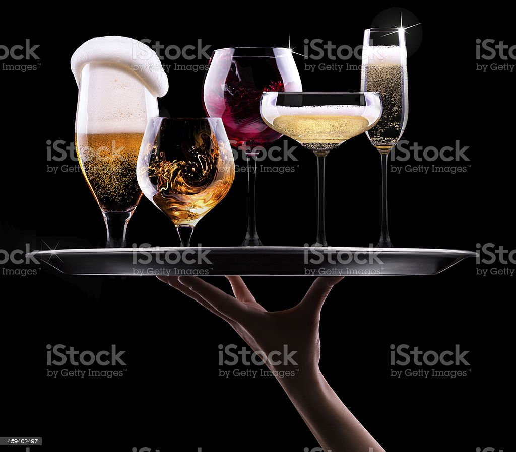 A serving tray with five different alcoholic beverages stock photo