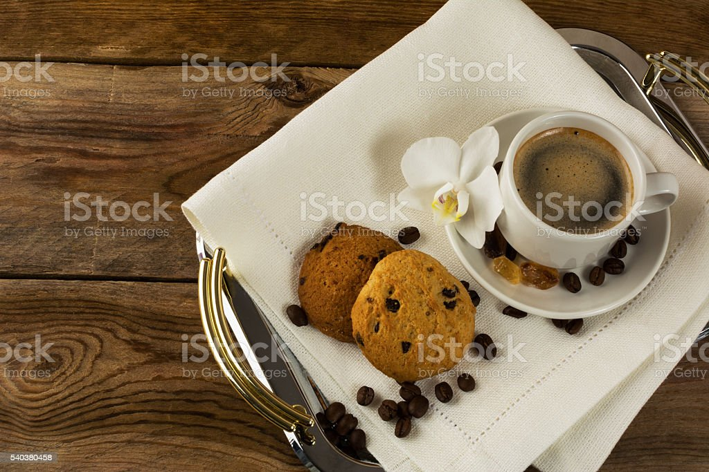 Serving tray with two coffee cups and white orchid stock photo
